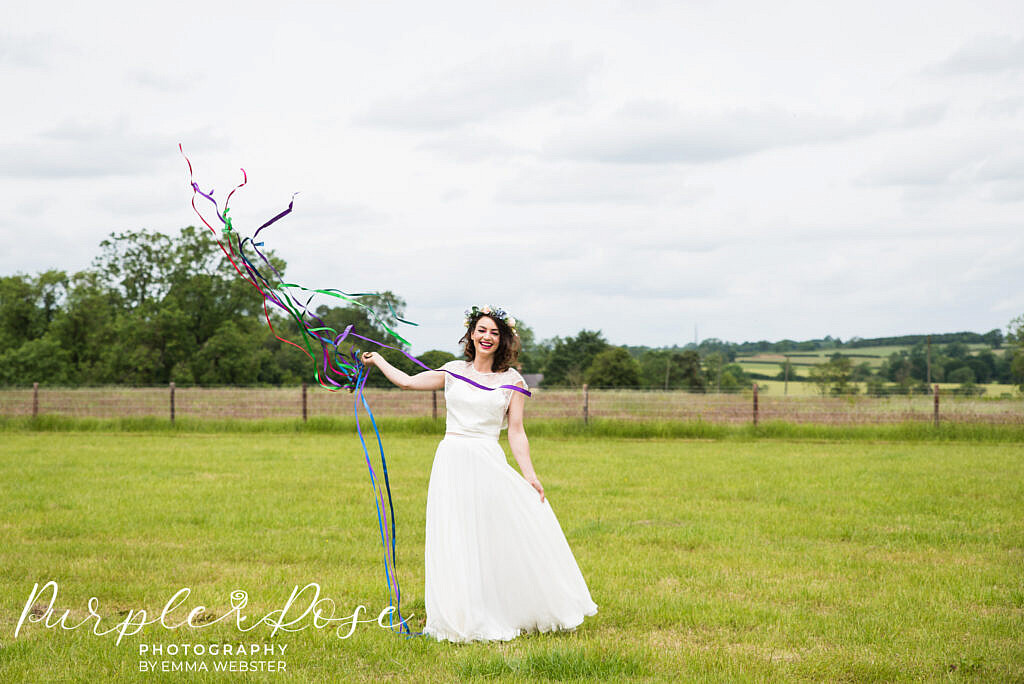 bride laughing in a field
