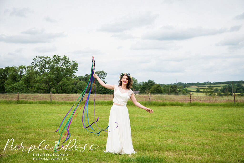 Bride in a field giggeling