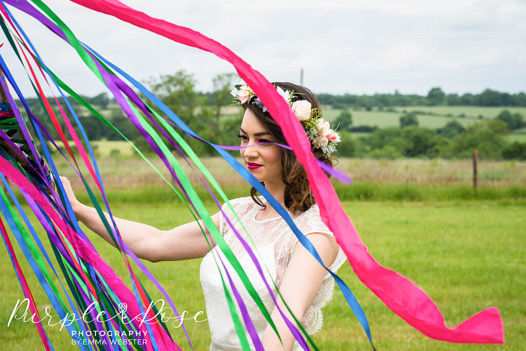 Bride looking through ribbons