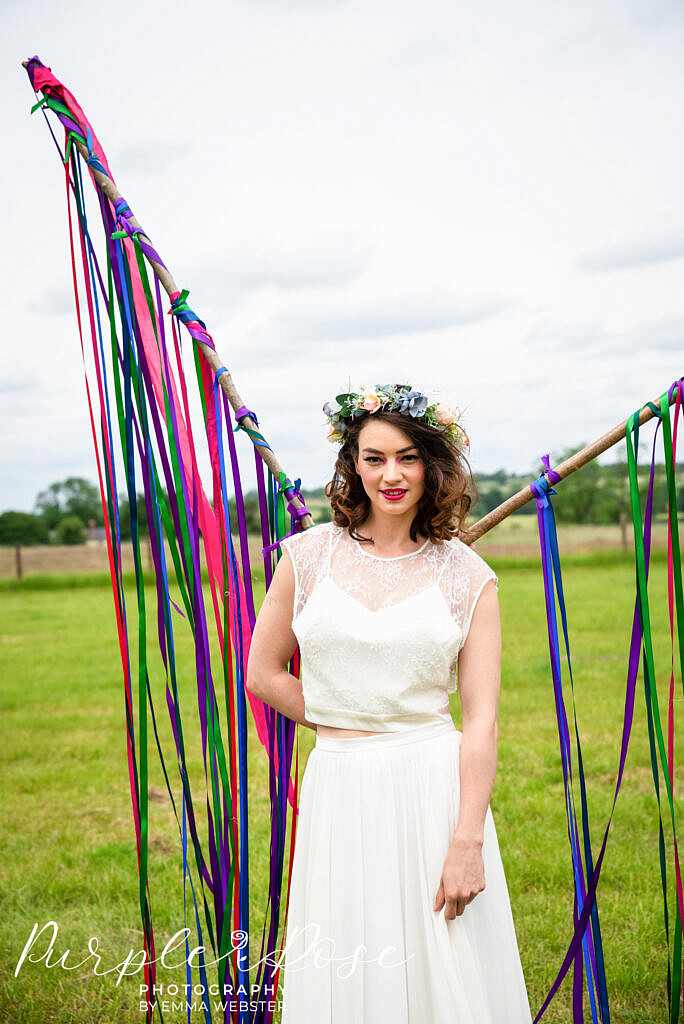 Bride standing in front of ribbons