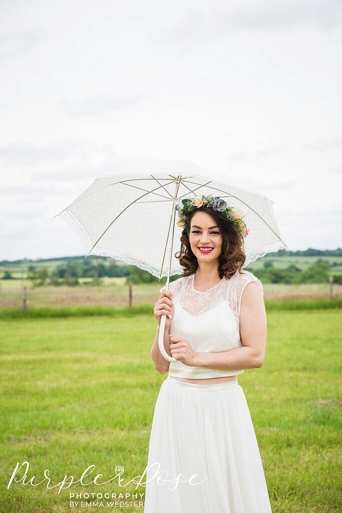 Bride holding a lace umbrella