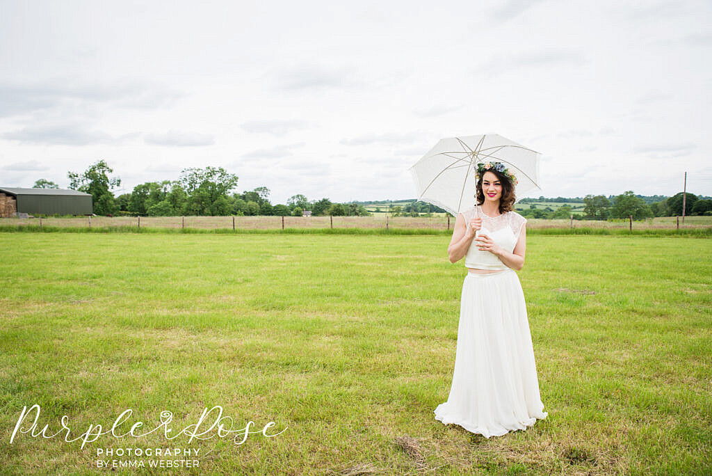 Bride with a white umbrella