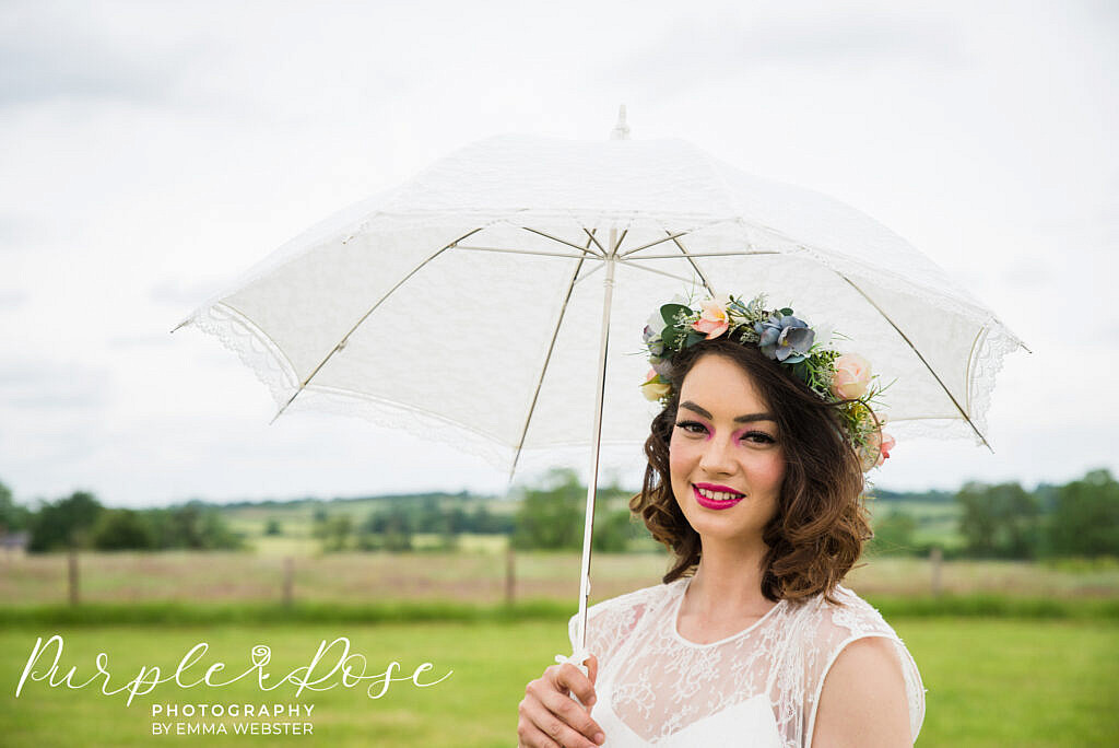 Bride with a white lace umbrella