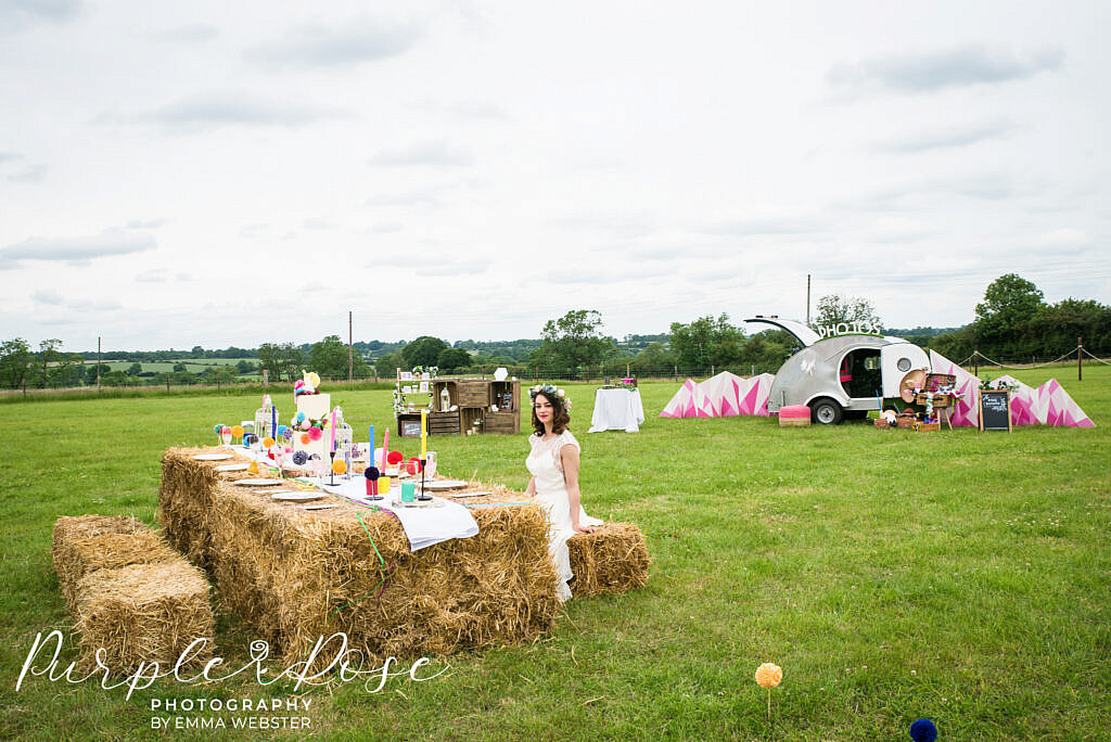 Bride sitting on haystack
