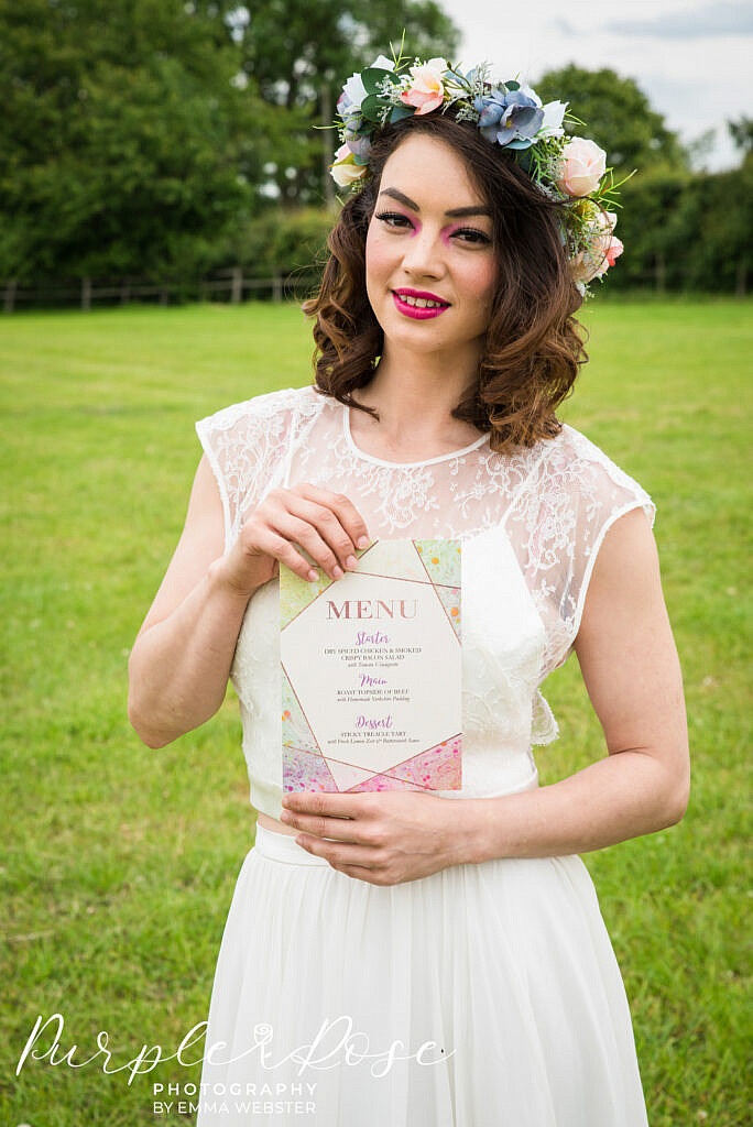 bride holding a menu