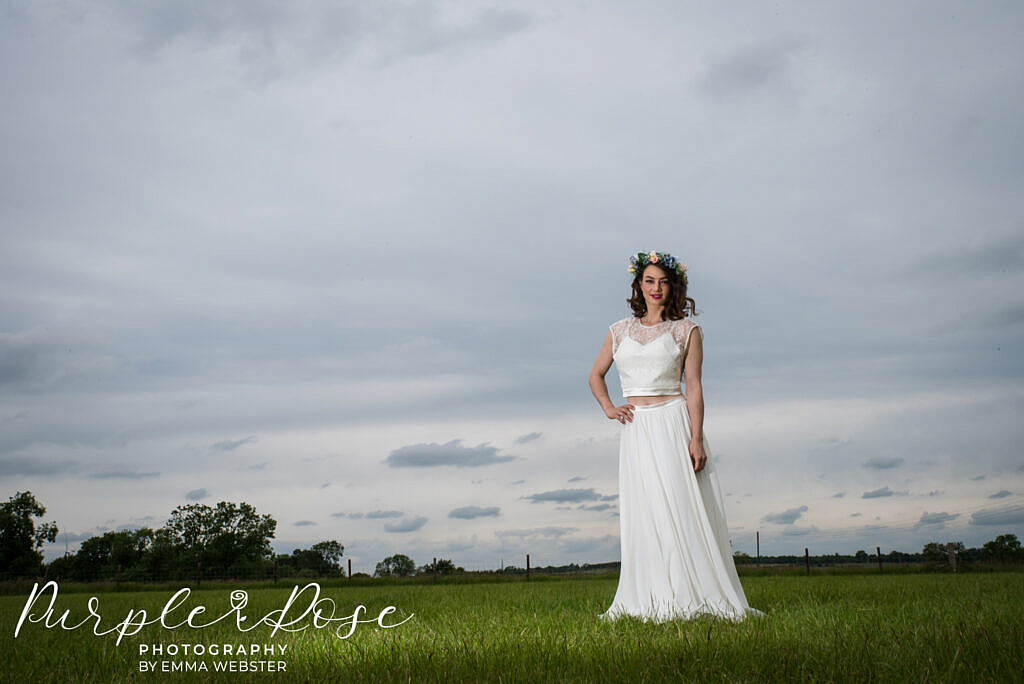bride with stormy sky behind her