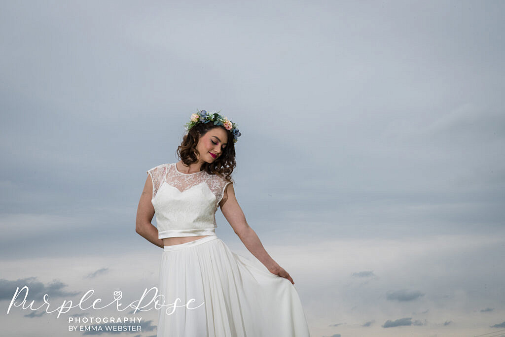 bride in front of a dark sky