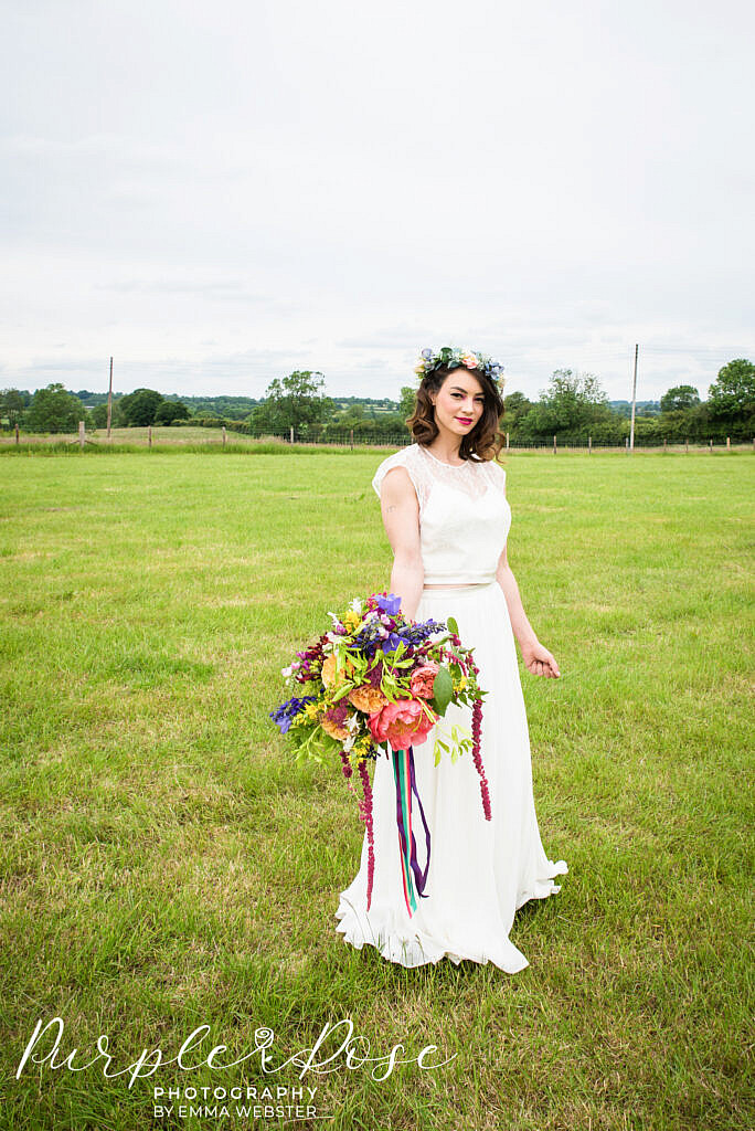 bride standing with her flowers