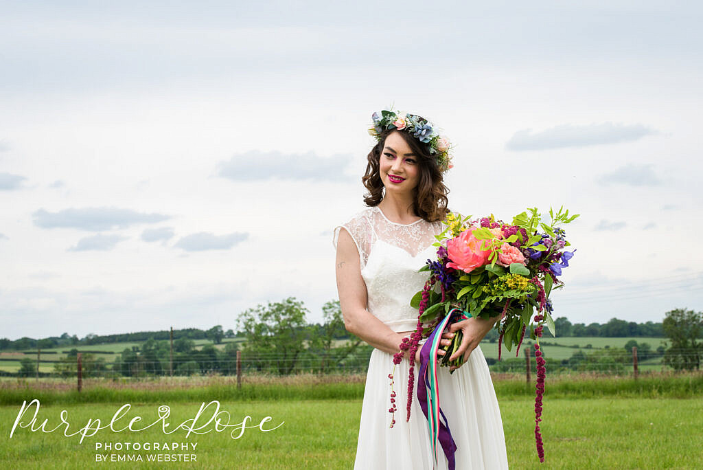 bride standing with her wedding flowers