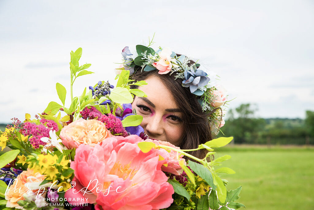 bride surrounded by flowers