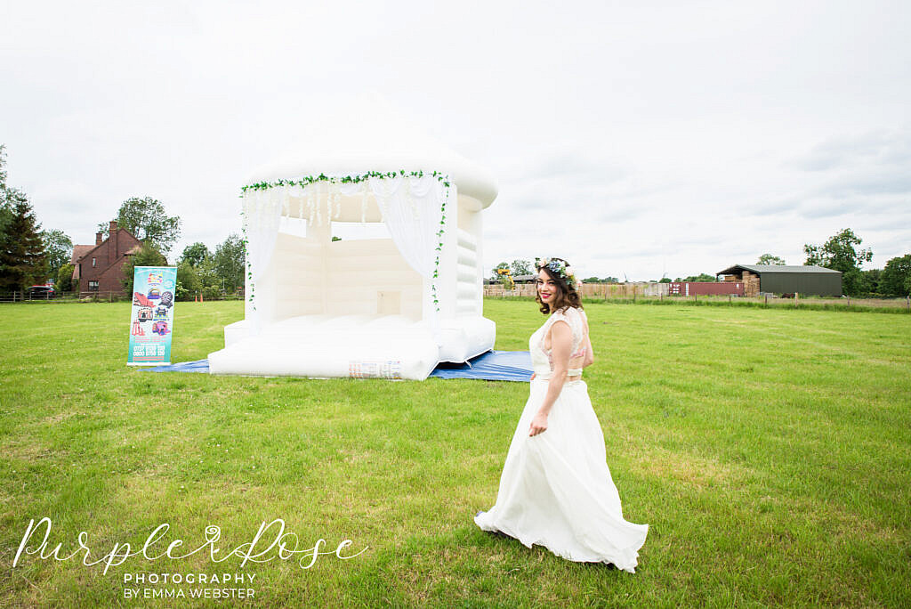 Bride walking to a bouncy castle