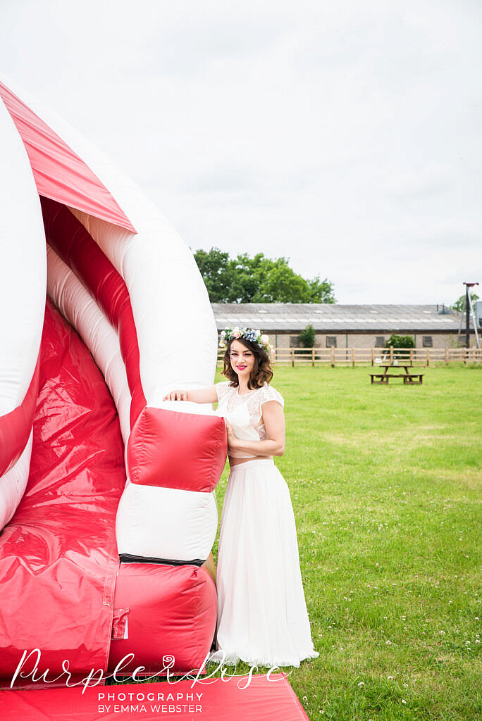 bride leaning on a bouncy castle
