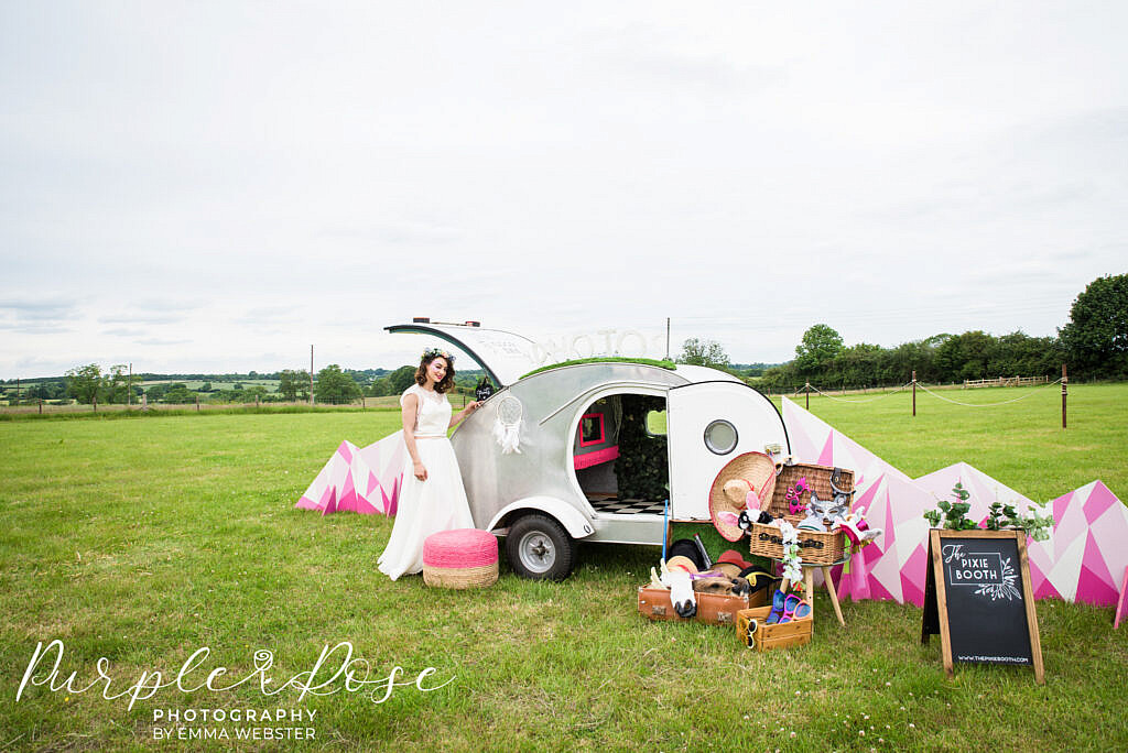 Bride with a photo booth camper van