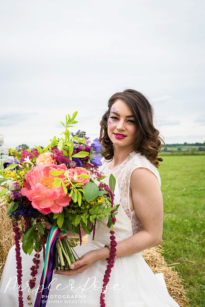 Bride sitting in a field