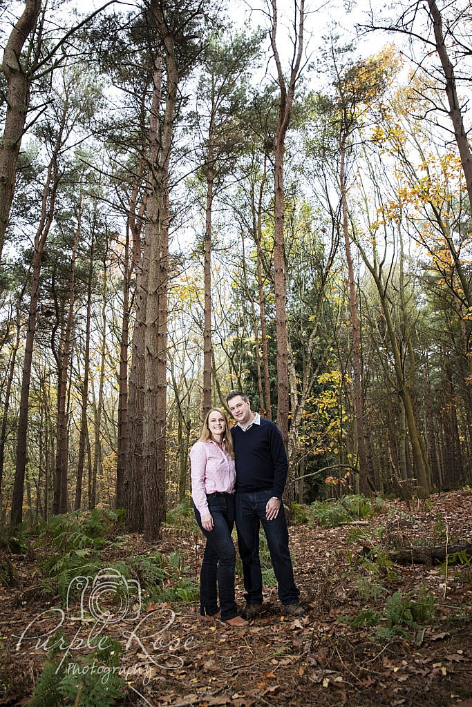 Couple standing in a forest