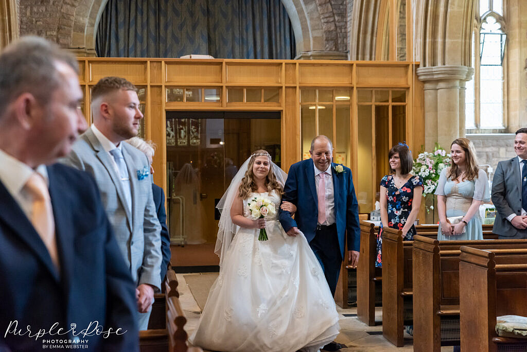 Bride and her father walking into the church