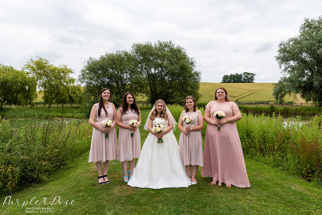 Bride posing with her bridesmaids