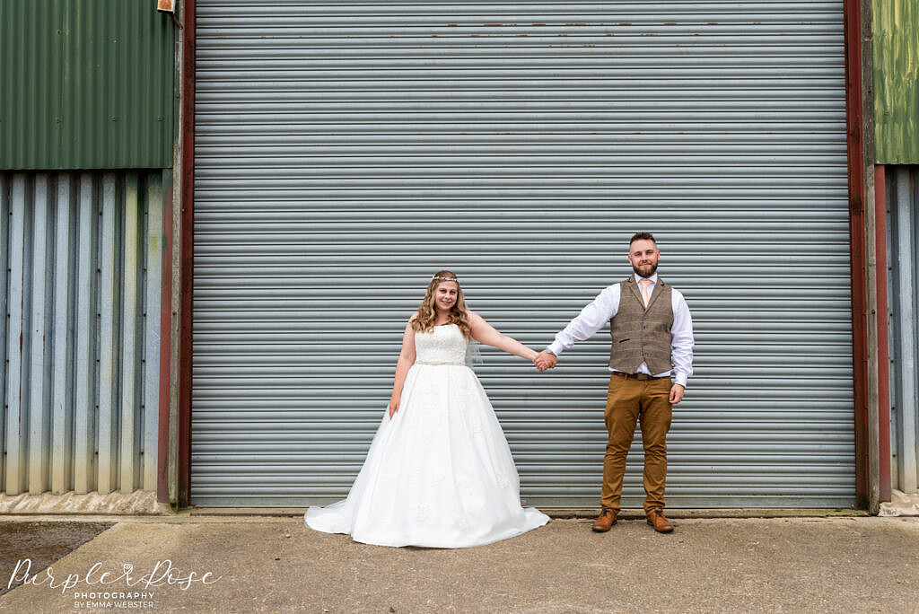Couple in front of a barn door