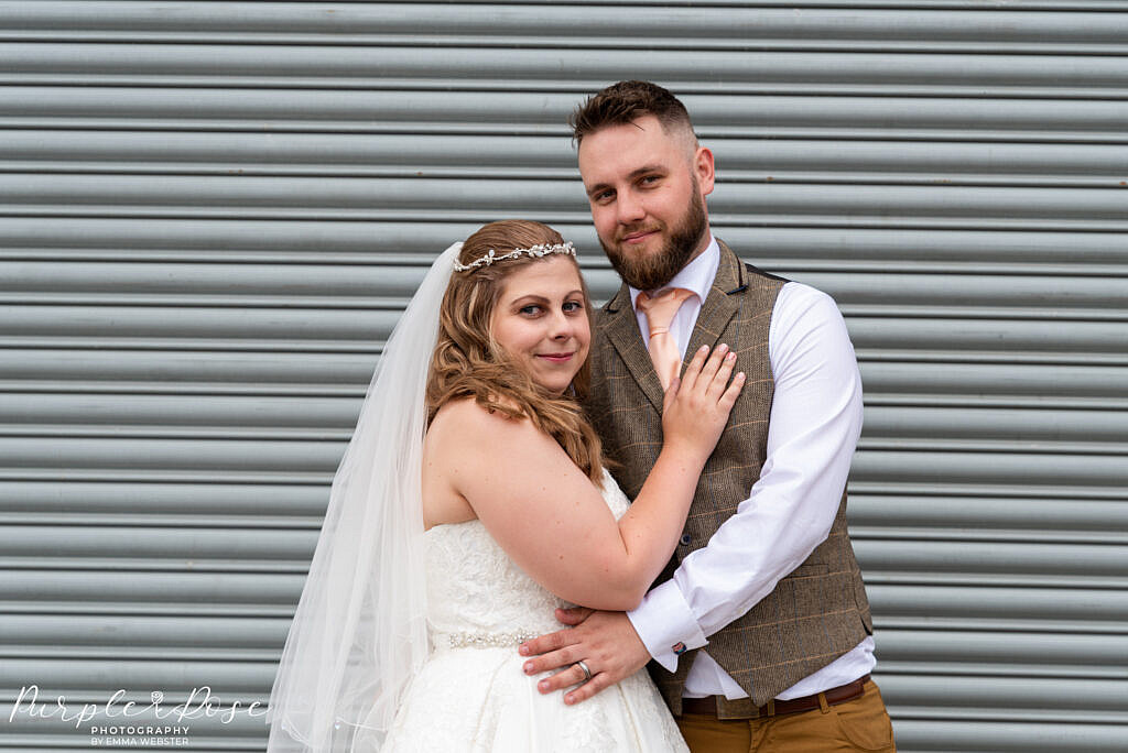 Couple in front of metal barn door