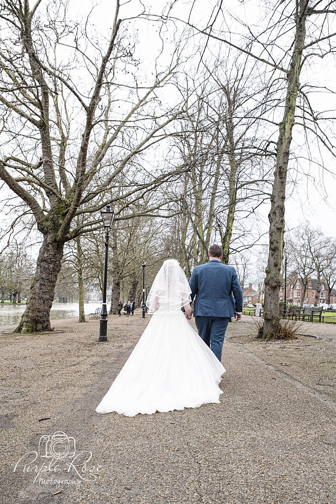 Bride and groom walking besides Bedford River Bank