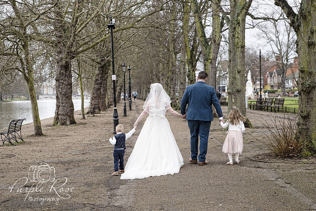 Bride, groom and their children walking together