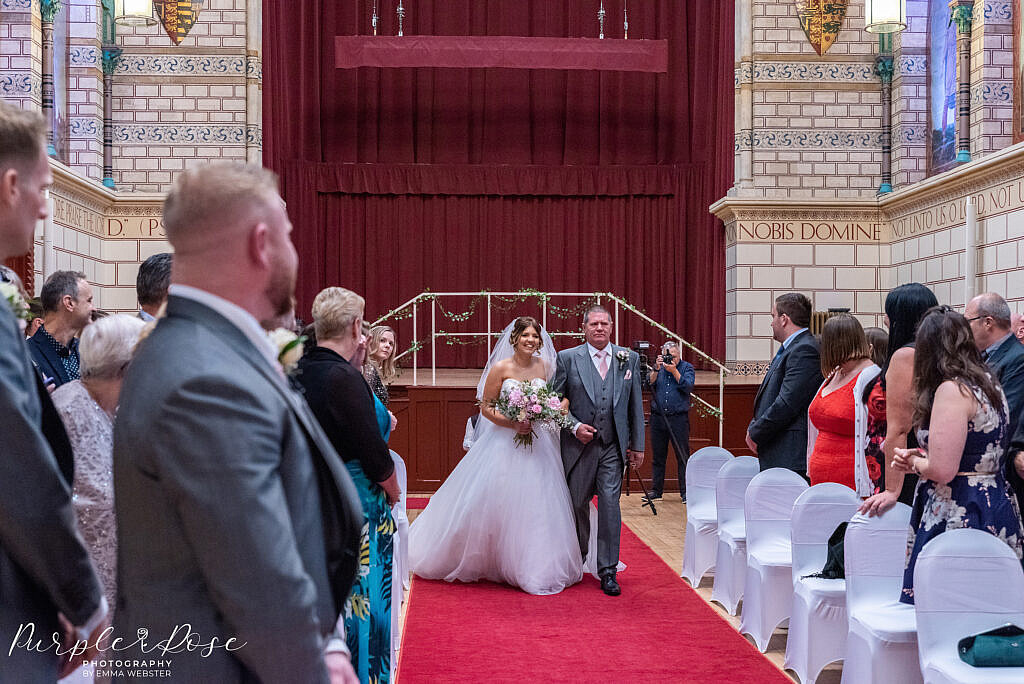 Bride walking with her father in the Guildhall Northampton