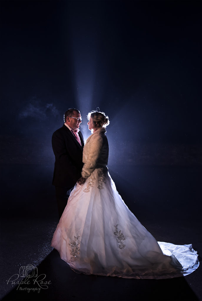 Night time photo of a bride and groom