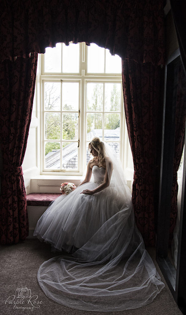 Bride sat by a window