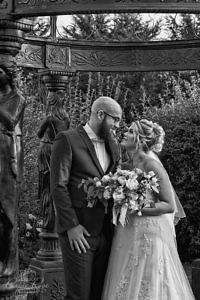 Bride and groom standing in a garden