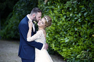 Bride and Groom in the gardens at Pendley Manor