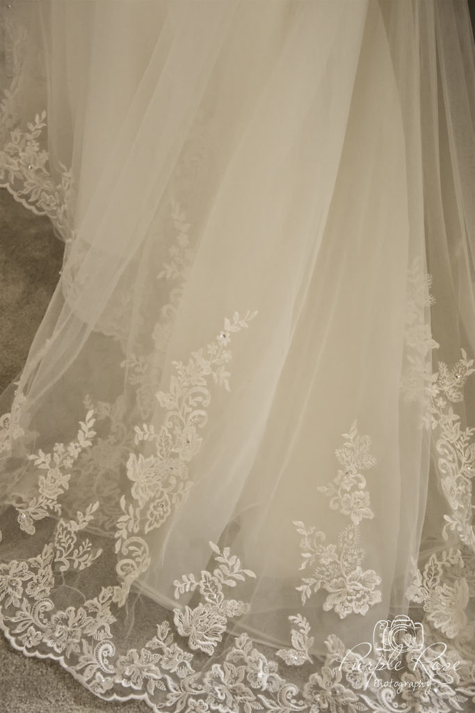 Detail of the lace on a brides wedding dress