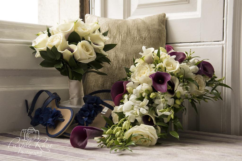 Photo of brides bouquet, brides maids bouquet and brides shoes.