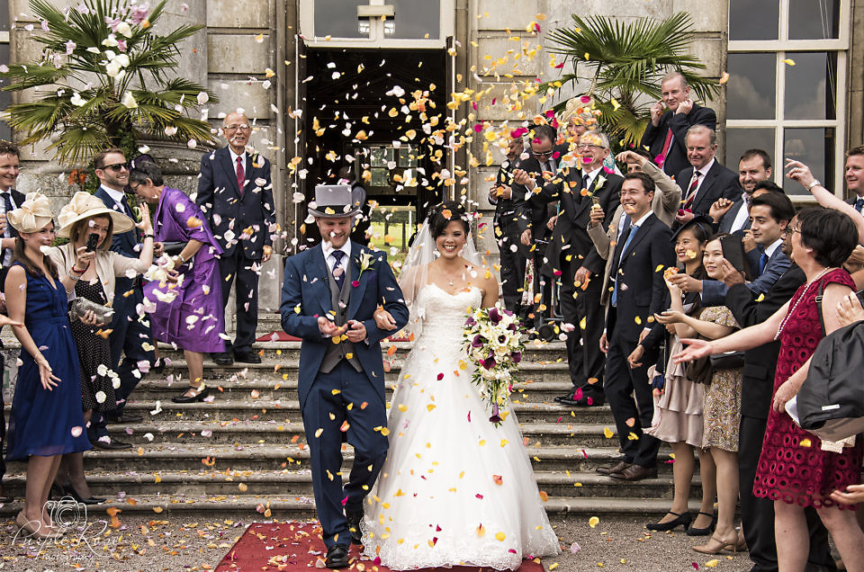 Bride & Groom covered in confetti at Moor Park Mansion