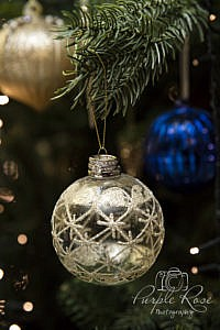Wedding rings on a Christmas bauble