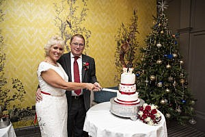 Bride & Groom cutting their cake