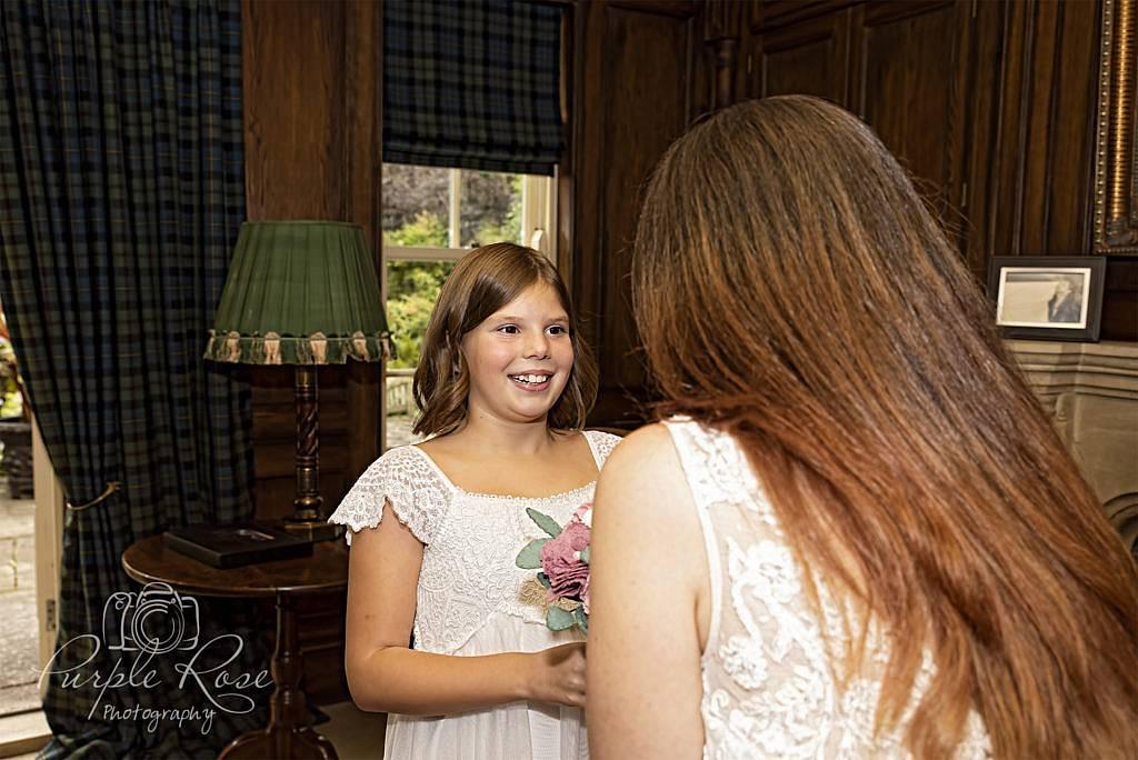 Flower girl smiling at bride