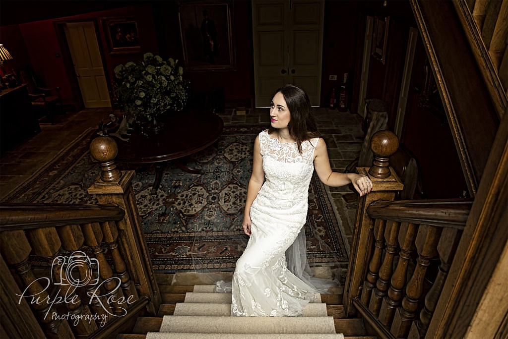 Bride walking up a staircase