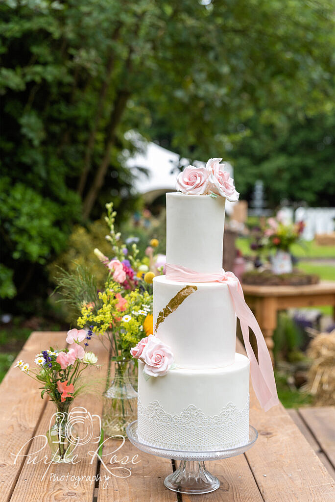 Wedding cake surrounded by flowers