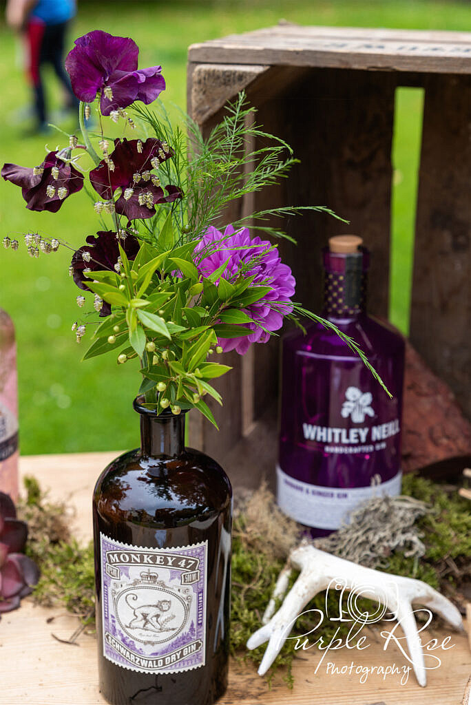 Flowers in gin bottles