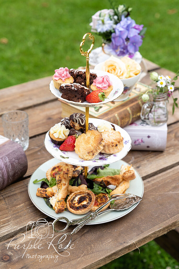 Afternoon tea food surrounded by flowers