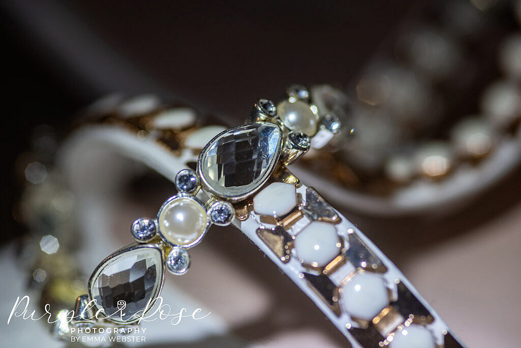 Detail of a brides shoes and bracelet