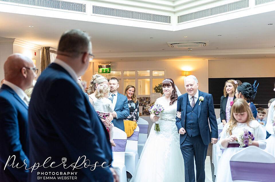 bride walking to her groom