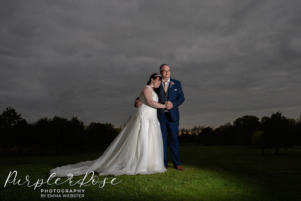 Bride and groom in front of a stormy sky