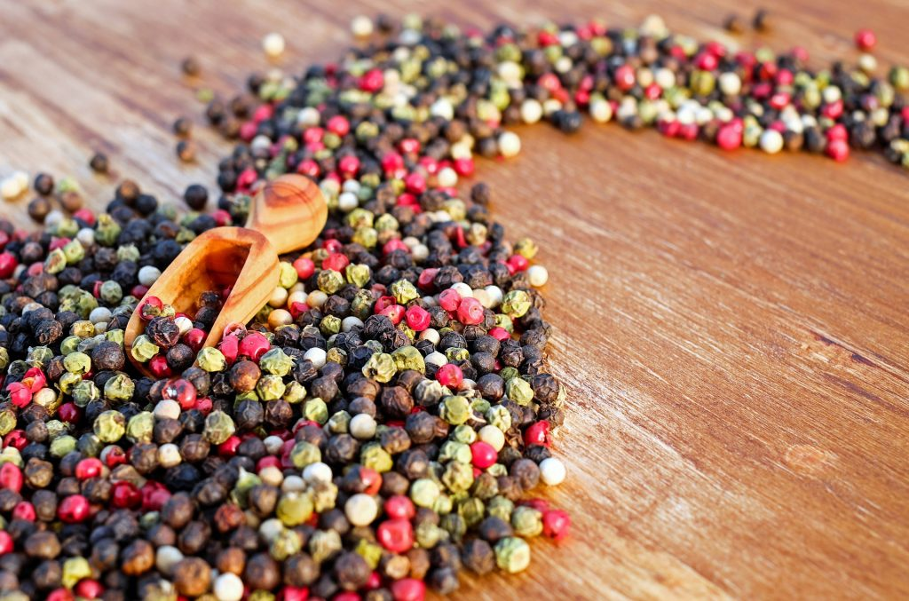 a swirl of peppercorns in different colours