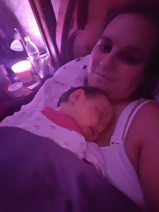 Young alyssa sleeping on mummys chest
