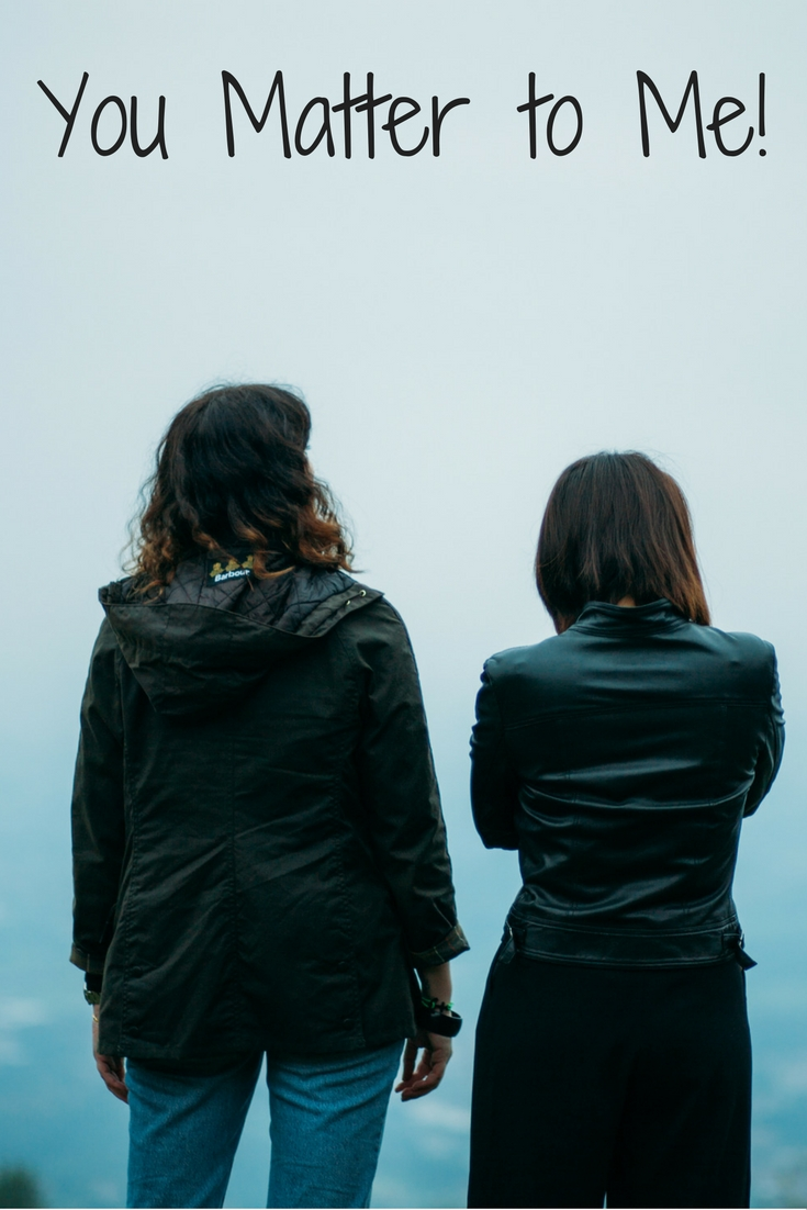 Two girls standing side by side with clouds behind them and title of blog post at the top