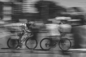 a blurred busy scene with bikes racing past