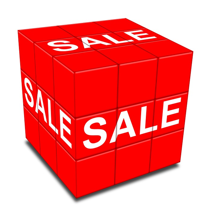 A red cube with the words sale in white