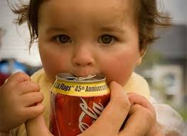 baby drinking a can of coke
