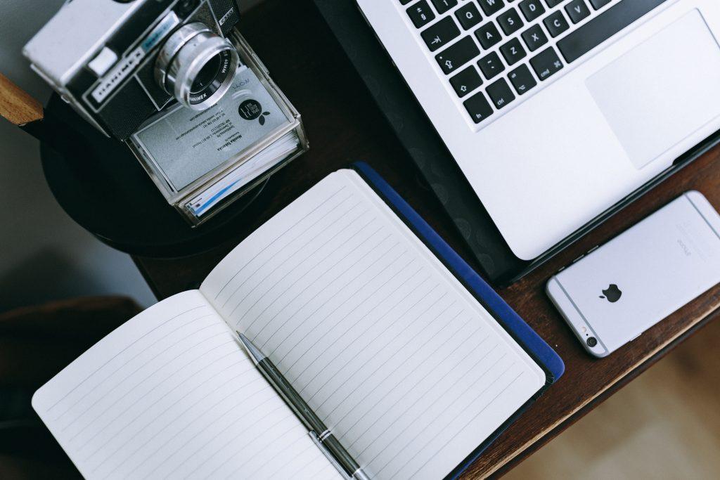 computer phone notebook and camera